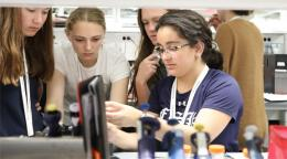 CURIE Academy participants gather in a lab to work on a research project