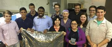 Some members of the team that worked on the Alpha 1U cubesat in Mason Peck's lab.
