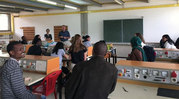 Meinig School Professors Schaffer and Nishimura in classroom in Tanzania