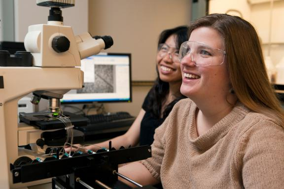 Professor Susan Daniel shares a laugh in the lab with a student