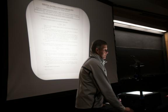 Lecturer using an overhead projector during a class