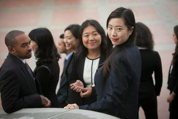 Two female students in suits