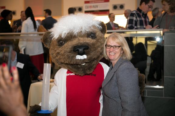 June Losurdo poses with Touchdown the bear, Cornell's mascot at an alumni event