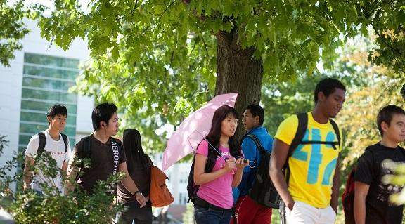 Photo of students walking through engineering quad in summer