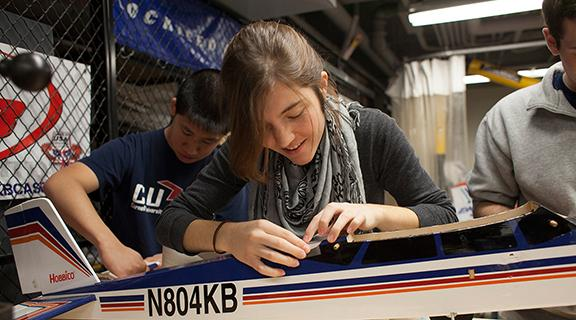 Female engineering student working on autonomously controlled airplane