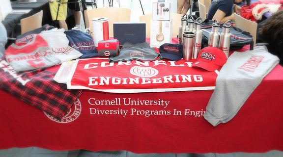 Table display of Cornell University, Cornell Engineering, and DPE branded merchandise