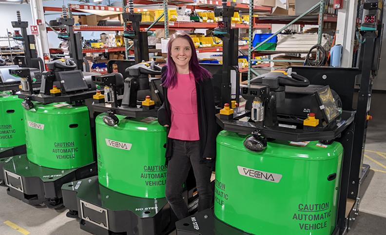Katie Bradford with Vecna Robotics autonomous vehicles