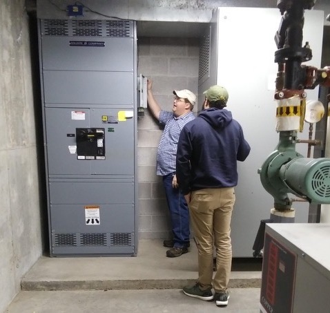 two people installing equipment