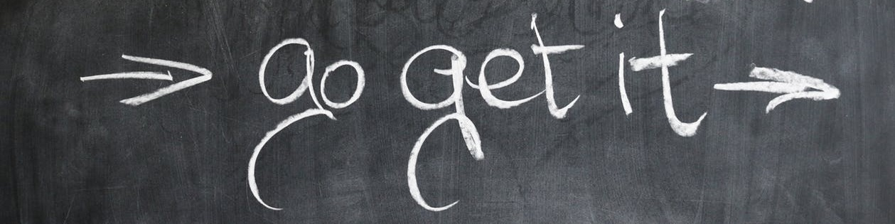 """go get it"" written on chalk board"