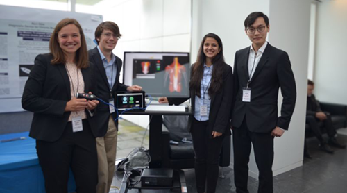 Qiwei Li and classmate team members Kerianne Coulon, Graham Thomas, and Nairuti Jhala presenting the Noci-Stim device at M.Eng. Industry Day in May 2019.