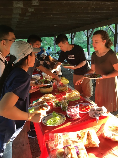 2018 students having a BBQ in Cass Park after a boat cruise